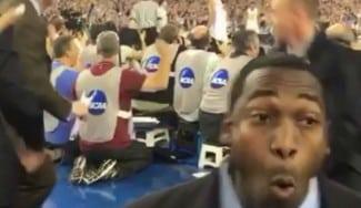 Sin mirar a pista: así reacciona un miembro de seguridad al triple ganador NCAA (Vídeo)