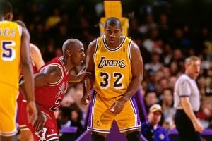 INGLEWOOD, CA - 1996: Michael Jordan #23 of the Chicago Bulls defends against Magic Johnson #32 of the Los Angeles Lakers circa 1996 at the Great Western Forum in Inglewood, California. NOTE TO USER: User expressly acknowledges and agrees that, by downloading and or using this photograph, User is consenting to the terms and conditions of the Getty Images License Agreement. Mandatory Copyright Notice: Copyright 1996 NBAE (Photo by Andrew D. Bernstein/NBAE via Getty Images)